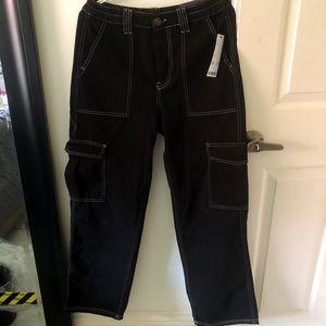 Black jeans, white stitches